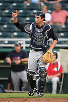 Tampa Yankees catcher Kyle Higashioka (25) signals two outs during a game against the Fort Myers Miracle on April 15, 2015 at Hammond Stadium in Fort Myers, Florida.  Tampa defeated Fort Myers 3-1 in eleven innings.  (Mike Janes/Four Seam Images)