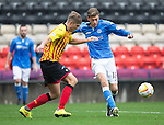 Partick Thistle v St Johnstone....25.10.14   SPFL<br /> Murray Davidson takes on Frederic Frans<br /> Picture by Graeme Hart.<br /> Copyright Perthshire Picture Agency<br /> Tel: 01738 623350  Mobile: 07990 594431