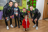 Pictured: (L-R) Ben Cabango, Jay Fulton and Matt Grimes of Swansea City at Morriston Hospital, Swansea, Wales, UK. Thursday 19 December 2019