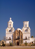 "Mission San Xavier del Bac (""""The White Dove of the Desert"""") was built in 1783-1797 by Franciscan missionaries. Since 1911, it has been maintained as the main church and school of the Tohono O'Odham Indian Reservation. Tucson Arizona USA."