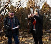 Hilmar Örn Hilmarsson high priest (or gothi) of Iceland's neo-pagan Ásatrúarfélagið or Asatru association calls out to the deities at the hight of the solar eclipse in Reykjavik Iceland.