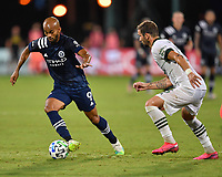 LAKE BUENA VISTA, FL - AUGUST 01: Héber #9 of New York City FC is dribbles away from Dario Zuparic #13 of the Portland Timbers during a game between Portland Timbers and New York City FC at ESPN Wide World of Sports on August 01, 2020 in Lake Buena Vista, Florida.