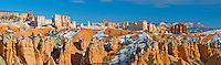 Panorama of the hoodoos deep within Bryce Amphitheater, Bryce Canyon National Park, Utah. Hoodoos are pinnacles or odd-shaped rock left standing by the forces of erosion. Technically not a canyon, most of the erosion at Bryce comes from the freezing and thawing of water, a prevalent occurence due to its high elevation of approximately 7,000 to 9,000 feet (2,133 - 2,743 m). In addition to ice, wind and water erosion also play a role.