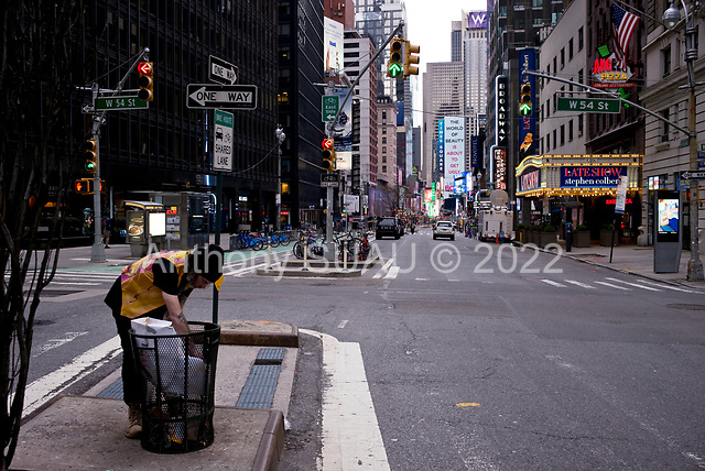"""New York, New York<br /> April 4, 2020<br /> <br /> The 7th Avenue in mid-town Manhattan.<br /> <br /> The coronavirus has transformed urban architectural spaces with fear of proximity. Not entirely void of humanity, social distancing, within expansive city environments has created a landscape of aggrandizing physical structures and expanding spaces while diminishing the scale of humans. Face masks enhance the anonymity of """"the person"""", reducing them to a figure or an uninterrupted shadow falling on a surface."""