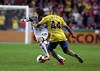 Saturday 28 September 2013<br /> Pictured L-R: Alejandro Pozuelo of Swansea against Serge Gnabry of Arsenal<br /> Re: Barclay's Premier League, Swansea City FC v Arsenal at the Liberty Stadium, south Wales.