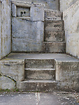 Concrete stairway in decommissioned military gunnery bunker.  Fort Casey State Park, Washington State.
