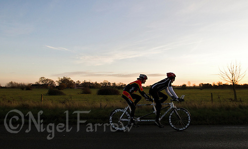 10 DEC 2011 - NORFOLK, GBR - As the sun drops behind the horizon Iain Dawson (left) and guide Luke Watson (right) take the new tandem for a ride (PHOTO (C) NIGEL FARROW)