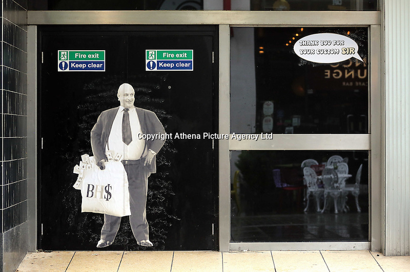 """Pictured: A poster of Sir Philip Green on the door of the now closed down BHS store in Oxford Street, Swansea, Wales, UK. Tuesday 13 September 2016<br /> Re: Former owner of BHS, Sir Philip Green has paid a surprise 'visit' to the closed down BHS store in Swansea.<br /> He was spotted in the doorway of the Oxford Street store, which closed its doors for the last time last month.<br /> In his hand was a BHS shopping bag with money spilling out of it.<br /> Sir Philip had owned BHS before selling it for £1 last year.<br /> He is claimed to have taken millions out of the company in dividends and left behind a £571m pensions deficit.<br /> Alongside the poster are the words: """"Thankyou for your custom Sir""""."""