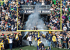Oct 11, 2014; The football team runs out of the tunnel for the North Carolina game. (Photo by Matt Cashore)