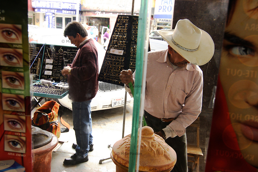 Man sweeping; Progreso, Mexico; 1116am, 7Dec2005