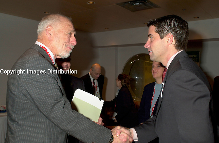 March 19 2003, Montreal, Quebec, Canada<br /> <br /> Andre Boisclair, Quebec's Environment Minister (R) shake hands with<br /> David Anderson ,Canada's  Environment Minister, (L)  before  the  opening plenary session of Americana ;  a 3 days conference and  trade show on environment and waste management organized by Reseau Environnement, March 19, 2003 in Montreal, Canada.<br /> <br /> Mandatory Credit: Photo by Pierre Roussel- Images Distribution. (©) Copyright 2003 by Pierre Roussel <br /> <br /> NOTE : <br />  Nikon D-1 jpeg opened with Qimage icc profile, saved in Adobe 1998 RGB<br /> .Uncompressed  Original  size  file availble on request.
