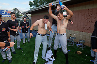 Batavia Muckdogs Nic Ready (3), Evan Brabrand, and Sean Reynolds (back) celebrate after clinching the Pinckney Division Title during a NY-Penn League game against the Auburn Doubledays on September 2, 2019 at Falcon Park in Auburn, New York.  Batavia defeated Auburn 7-0 to clinch the Pinckney Division Title.  (Mike Janes/Four Seam Images)