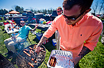 LEXINGTON, KENTUCKY - APRIL 08: A fan pulls some hot dogs off the grill on The Hill on Blue Grass Stakes Day at Keeneland Race Course on April 8, 2017 in Lexington, Kentucky. (Photo by Scott Serio/Eclipse Sportswire/Getty Images)