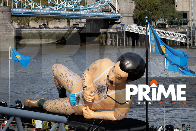 a Giant Inflatable Borat is seen on a barge on the River Thames by Tower Bridge at City of London, London, England on 22 October 2020. Photo by Vince  Mignott.