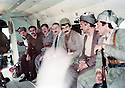 Iraq 1984 <br />   On their way  for negociations with Iraqi authorities , a Kurdish delegation in an helicopter with Jalal Talabani, Abdul Rahman Ghassemlou, Mala Bakhtyiar, Mullazem Omar Abdallah and an Iraqi officer  <br /> Irak 1984 <br /> Une delegation de Kurdes accompagnee d'un officier irakien en route pour negotier avec les autorites irakiennes