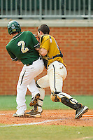 Cory Tilton #2 of the Charlotte 49ers collides with catcher Andreas Plackis #55 of the Missouri Tigers at Robert and Mariam Hayes Stadium on February 27, 2011 in Charlotte, North Carolina.  Photo by Brian Westerholt / Four Seam Images