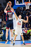 Bayern Munich´s player Savanovic and Real Madrid´s player Jayce Carroll and  during the 4th match of the Turkish Airlines Euroleague at Barclaycard Center in Madrid, Spain, November 05, 2015. <br /> (ALTERPHOTOS/BorjaB.Hojas)