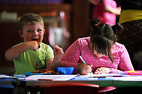 Pictured L-R: Ashton Crane, 3 with sister Alisha, 7, enjoy hot food at St Teilo Church in Clase, Swansea, UK. Friday 25 August 2017<br /> Re: Free food for children story, Swansea, Wales, UK.