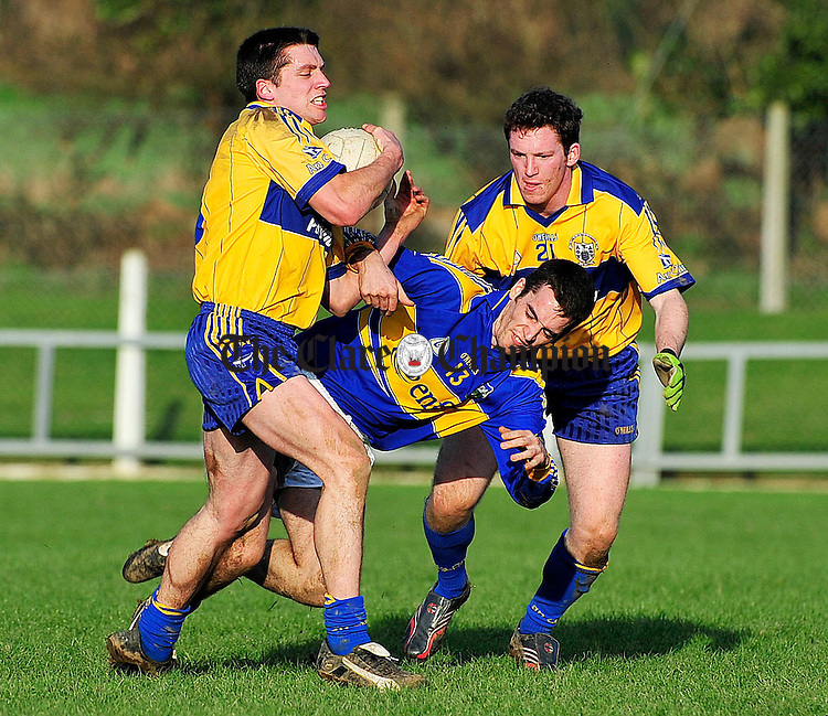 Clare v Tipperary Division 4 Round 2 football league at Ardfinnan co Tipperary.Pic Arthur Ellis...Clares Gordon Kelly and Greg Lyons battle with Tipperarys Eoin Kearney.