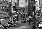 Pittsburgh PA: View of the 600 block of Liberty Avenue in Pittsburgh.  Nearby stores include; Duquesne Light Company Store, Wilkens Jewelers, F.W. Woolworth 5 and 10 cent store, Kings Clothing Store, Place Credit Clothing, Isaly's Dairy Store, and May's Drug Store