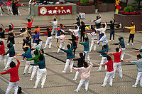 Gathering of taijiquan practitioners in a public center.