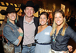 From left: Christine and Ty Hoffer with Molly Johnson and Ally Fields at the Cattle Baron's Ball at the George Ranch Saturday April 24,2010.. (Dave Rossman Photo)