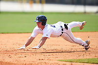 FCL Tigers West Austin Schultz (26) slides head first into second base during a game against the FCL Yankees on July 31, 2021 at Tigertown in Lakeland, Florida.  (Mike Janes/Four Seam Images)