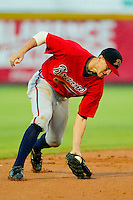 Shortstop Nick Ahmed #22 of the Danville Braves fields a ground ball against the Burlington Royals at Burlington Athletic Park on August 14, 2011 in Burlington, North Carolina.  The Braves defeated the Royals 10-2 in a game called by rain in the bottom of the 8th inning.   (Brian Westerholt / Four Seam Images)
