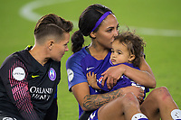 Orlando, FL - Saturday March 24, 2018: Orlando Pride goalkeeper Ashlyn Harris (24) looks at Orlando Pride forward Sydney Leroux (2) and her child after a regular season National Women's Soccer League (NWSL) match between the Orlando Pride and the Utah Royals FC at Orlando City Stadium. The game ended in a 1-1 draw.