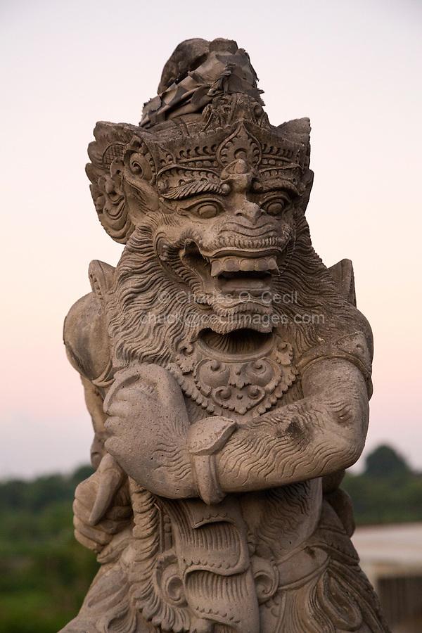 Bali, Indonesia.  Mythical Hindu Figure Guards a Bridge in Southern Bali.