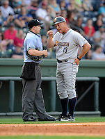 Manager Al Pedrique (13) of the Charleston RiverDogs argues with home plate umpire Andrew Freed in a game against the Greenville Drive on Sunday, April 7, 2013, at Fluor Field at the West End in Greenville, South Carolina. Charleston won, 5-0. (Tom Priddy/Four Seam Images)