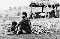 India, Narmada River, Narmada dams and protest movement of NBA Narmada Bachao Andolan, movement to save the Narmada river, and affected Adivasi in their villages, village Manibeli, September 1993, mother with child