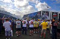 Mar 14, 2015; Gainesville, FL, USA; A crowd looks on as NHRA top fuel driver Antron Brown warms up in the pits during qualifying for the Gatornationals at Auto Plus Raceway at Gainesville. Mandatory Credit: Mark J. Rebilas-