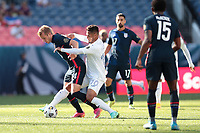 DENVER, CO - JUNE 3: Jackson Yueill #14 of the United States is defended by Alexander Lopez #10 of Honduras during a game between Honduras and USMNT at Empower Field at Mile High on June 3, 2021 in Denver, Colorado.