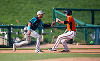 Lynchburg Hillcats third baseman Alexis Pantoja (6) tags Ryan McKenna (10) out during the first game of a doubleheader against the Frederick Keys on June 12, 2018 at Nymeo Field at Harry Grove Stadium in Frederick, Maryland.  Frederick defeated Lynchburg 2-1.  (Mike Janes/Four Seam Images)