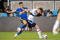 SAN JOSE, CA - AUGUST 13: Cristian Espinoza #10 of the San Jose Earthquakes challenges Jake Nerwinski #28 of the Vancouver Whitecaps during a game between San Jose Earthquakes and Vancouver Whitecaps at PayPal Park on August 13, 2021 in San Jose, California.