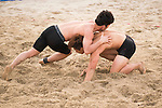 Wrestlers compete during the Beach Wrestling Men's competition between Vietnam and Korea on Day Eight of the 5th Asian Beach Games 2016 at Bien Dong Park on 01 October 2016, in Danang, Vietnam. Photo by Marcio Machado / Power Sport Images