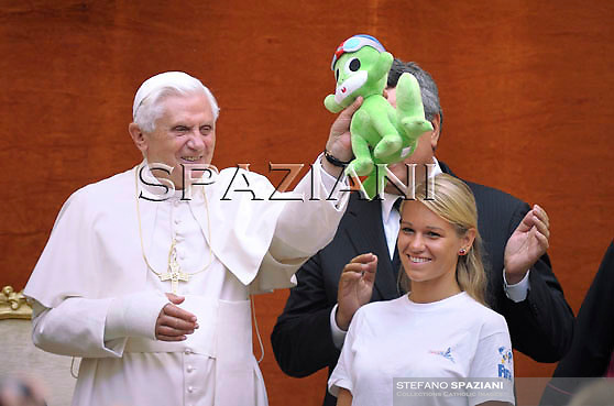 Pope Benedict XVI holds the official puppet of the swimming world championships called Diva during the audience for the competitors at his summer residence in Castelgandolfo south of Rome on August 1, 2009