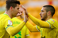 13th February 2021; Carrow Road, Norwich, Norfolk, England, English Football League Championship Football, Norwich versus Stoke City; Emi Buendia of Norwich City celebrates his goal with Kenny McLean for 3-1 in the 64th minute