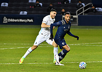 KANSAS, KS - DECEMBER 03: Khiry Shelton #11 of Sporting Kansas City drives the ball up midfield as Michael Boxall #15 of Minnesota United FC tries to keep up with him during a game between Minnesota United FC and Sporting Kansas City at Children's Mercy Park on December 03, 2020 in Kansas, Kansas.