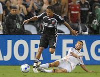 Los Angeles Galaxy midfielder Kyle Martino (18) slides to foul DC United midfielder Fred (7) earning him a red card. DC United defeated the Los Angeles Galaxy 1-0, at RFK Stadium Washington DC, Thursday August 9, 2007.