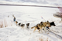 Louis Nelson Sr. runs up the bank of the Yukon River approaching Galena on Saturday morning during the 2008 Iditarod