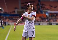 Megan Rapinoe #15 of the United States adjusts the captain's armband
