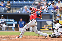 Hagerstown Suns third baseman Kelvin Gutierrez (5) swings at a pitch during a game against the Asheville Tourists at McCormick Field on June 6, 2016 in Asheville, North Carolina. The Tourists defeated the Suns 12-10. (Tony Farlow/Four Seam Images)