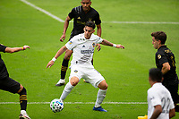 LOS ANGELES, CA - OCTOBER 25: Cristian Pavon #10 of the Los Angeles Galaxy moves to the ball during a game between Los Angeles Galaxy and Los Angeles FC at Banc of California Stadium on October 25, 2020 in Los Angeles, California.