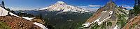 Panorama of a photographer by Pinnacle Peak in Mount Rainier National Park, Washington State.