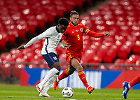 8th Occtober 2020, Wembley Stadium, London, England;  Wales Tyler Roberts held off by Englands Bukayo Saka during a friendly match between England and Wales in London