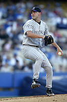 Denny Neagle of the Colorado Rockies pitches during a 2002 MLB season game against the Los Angeles Dodgers at Dodger Stadium, in Los Angeles, California. (Larry Goren/Four Seam Images)