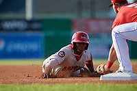 Auburn Doubledays Rafael Bautista (9) slides into third base where he is tagged out by Nic Ready (5) during a NY-Penn League game against the Batavia Muckdogs on June 18, 2019 at Dwyer Stadium in Batavia, New York.  Batavia defeated Auburn 7-5.  (Mike Janes/Four Seam Images)
