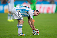 Lionel Messi of Argentina places the ball down for a free kick